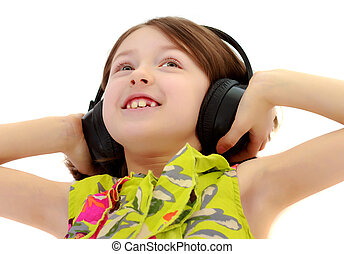 Little girl listening to music headphones.