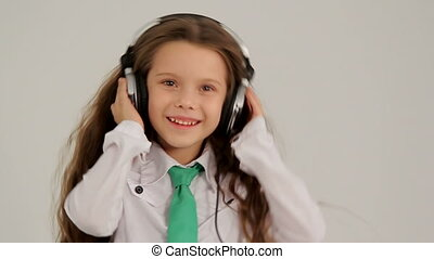 Little Girl Listening to Music With Headphones And Dancing