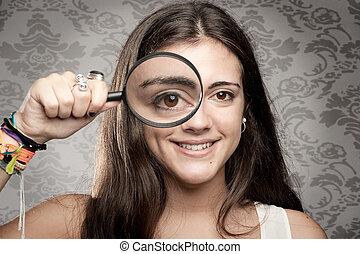 looking at camera through magnifying glass