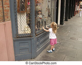 Little GIrl Looking At Doll In Window