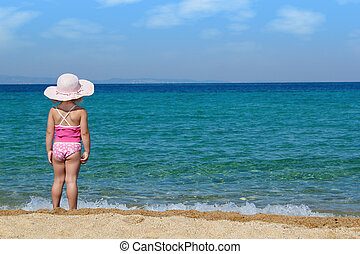 little girl looking at sea