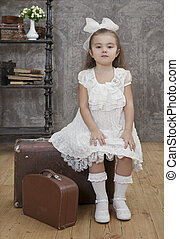 Little girl looking at the camera. Retro style