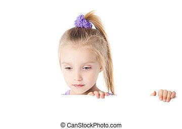 little girl looking over empty board
