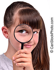 Little girl looking through a magnifying glass