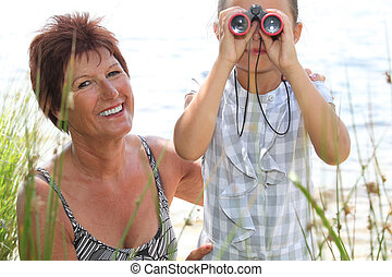 Little girl looking through binoculars
