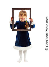 Little girl looking trough wooden frame