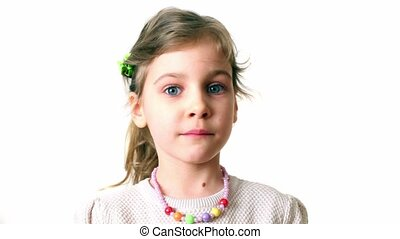 Little girl looks and turn around isolated on white...