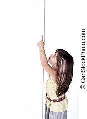 little girl looks at banner