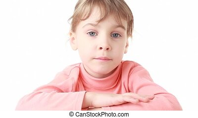 little girl looks at camera initially sadness, then happy