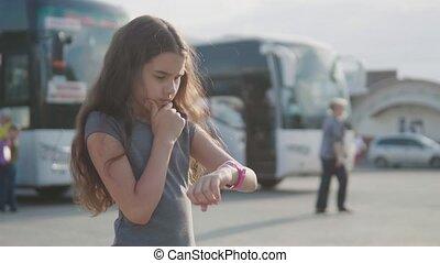 little girl looks at slow motion video smart internet clock...
