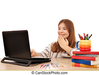 little girl looks at something fun on the laptop