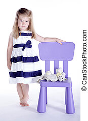 little girl looks sweet with chair