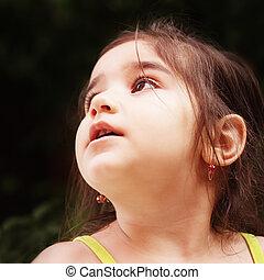 Little girl looks up