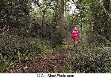 Little girl lost in a rain forest - Little girl walks on a...