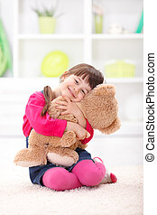 Little girl loving her plush bear - Little girl playing, ...