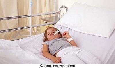Little girl lying in hospital bed