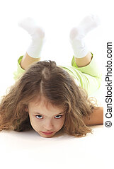 Little girl lying on a white background.