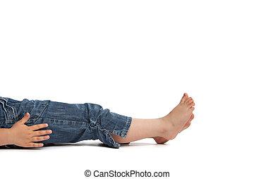little girl lying on back