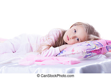 Little girl lying on bed