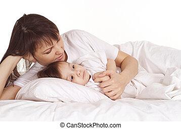 Little girl lying on bed