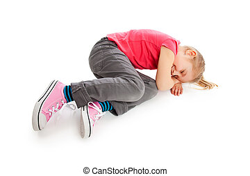 Little girl lying on floor.