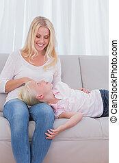 Little girl lying on her mother