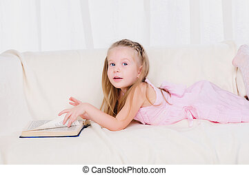 Little girl lying on the couch