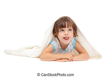 Little girl lying on the floor wrapped in a light blanket and tongue. Isolate on white.