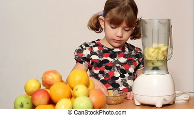 little girl make juice