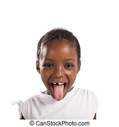Little girl makes a tongue