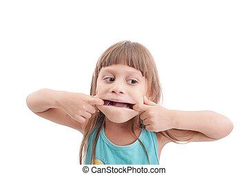 Little girl making a strange face on white background