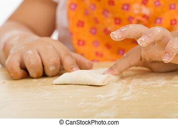 Little girl making cookies series