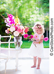 Little girl making flower arrangement - Little girl...