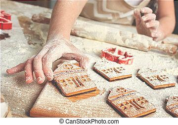 Little girl making gingerbread. Preparation for Christmas.