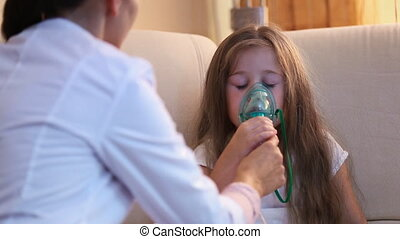 Little girl making inhalation