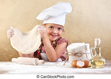 Little girl making pizza or pasta dough