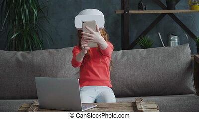 Little girl manipulate virtual reality