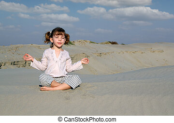little girl meditating in desert