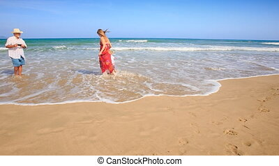Little Girl Mother in Red Grandpa Play in Foamy Wave Surf