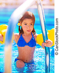 Little girl move out of the pool