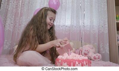 little girl near the cake