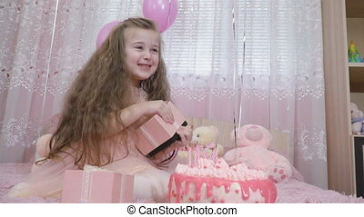 little girl near the cake