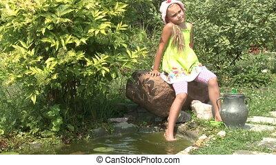 Little girl near the pond