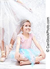 Little girl next to the ballet dancer