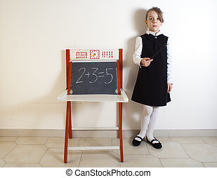 Little girl next to the chalkboard