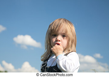 little girl on a background of the sky