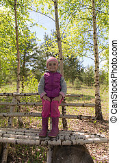 Little girl on a bench