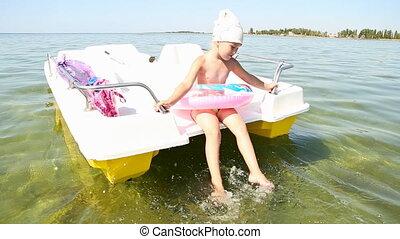 little girl on a catamaran - little girl in the sea on a...