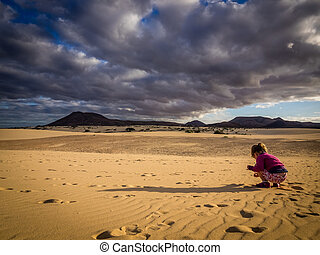 Little girl on a dunes