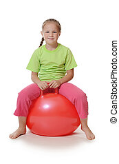 Little girl on a gymnastic ball